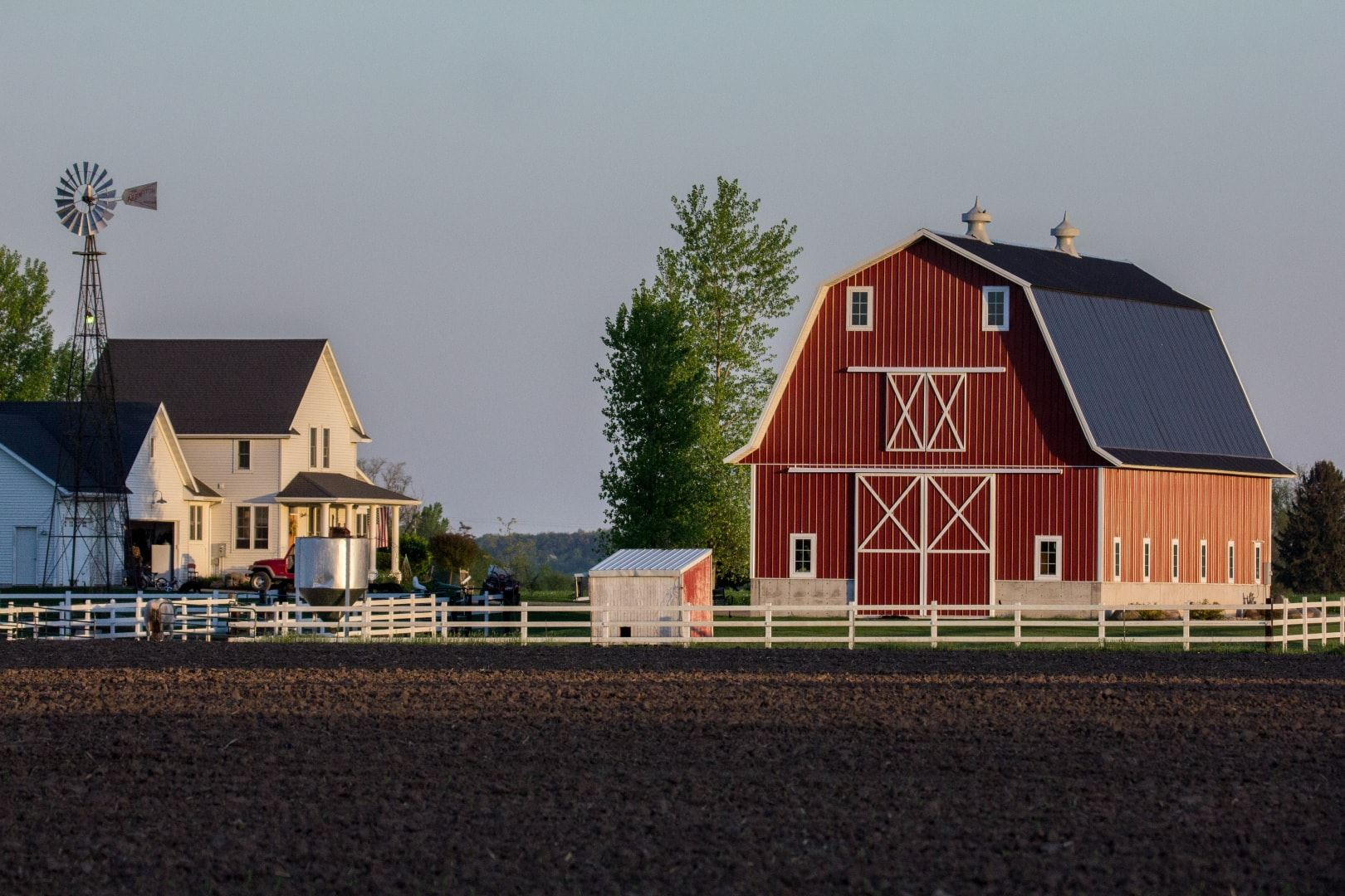 Red Barn, House, and White Fence