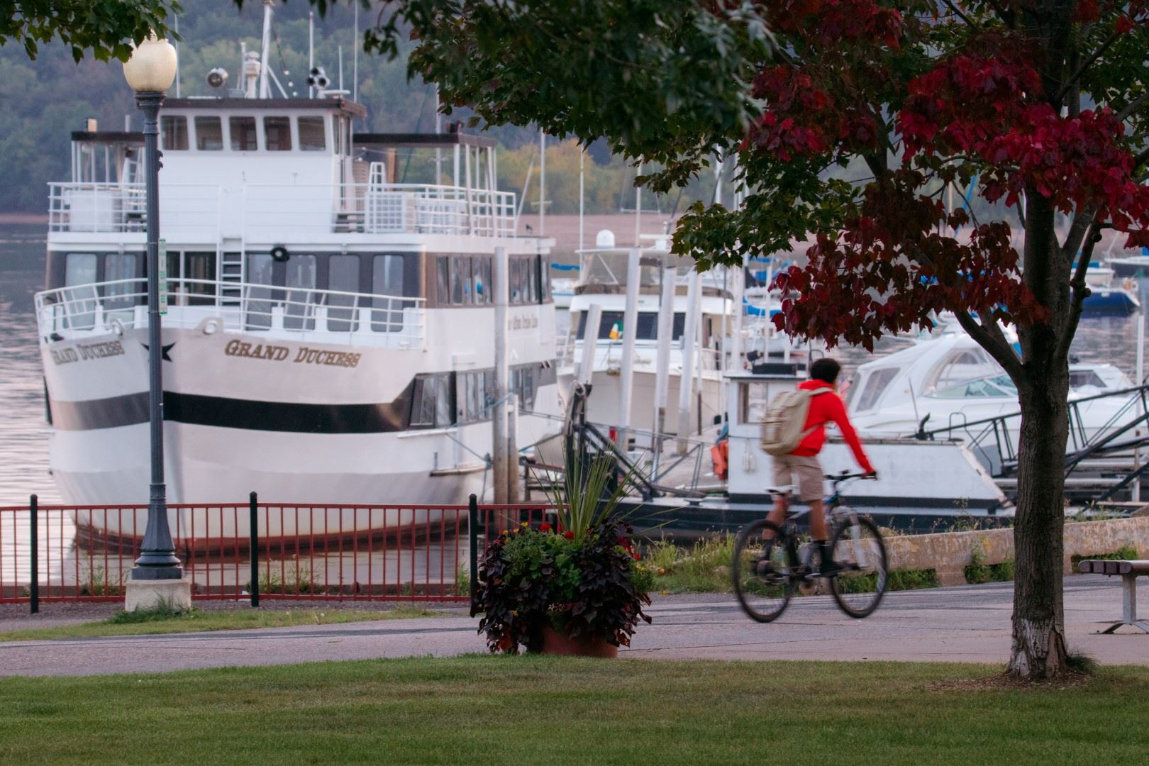 Grand Duchess Boat at Dock with Person on Bike