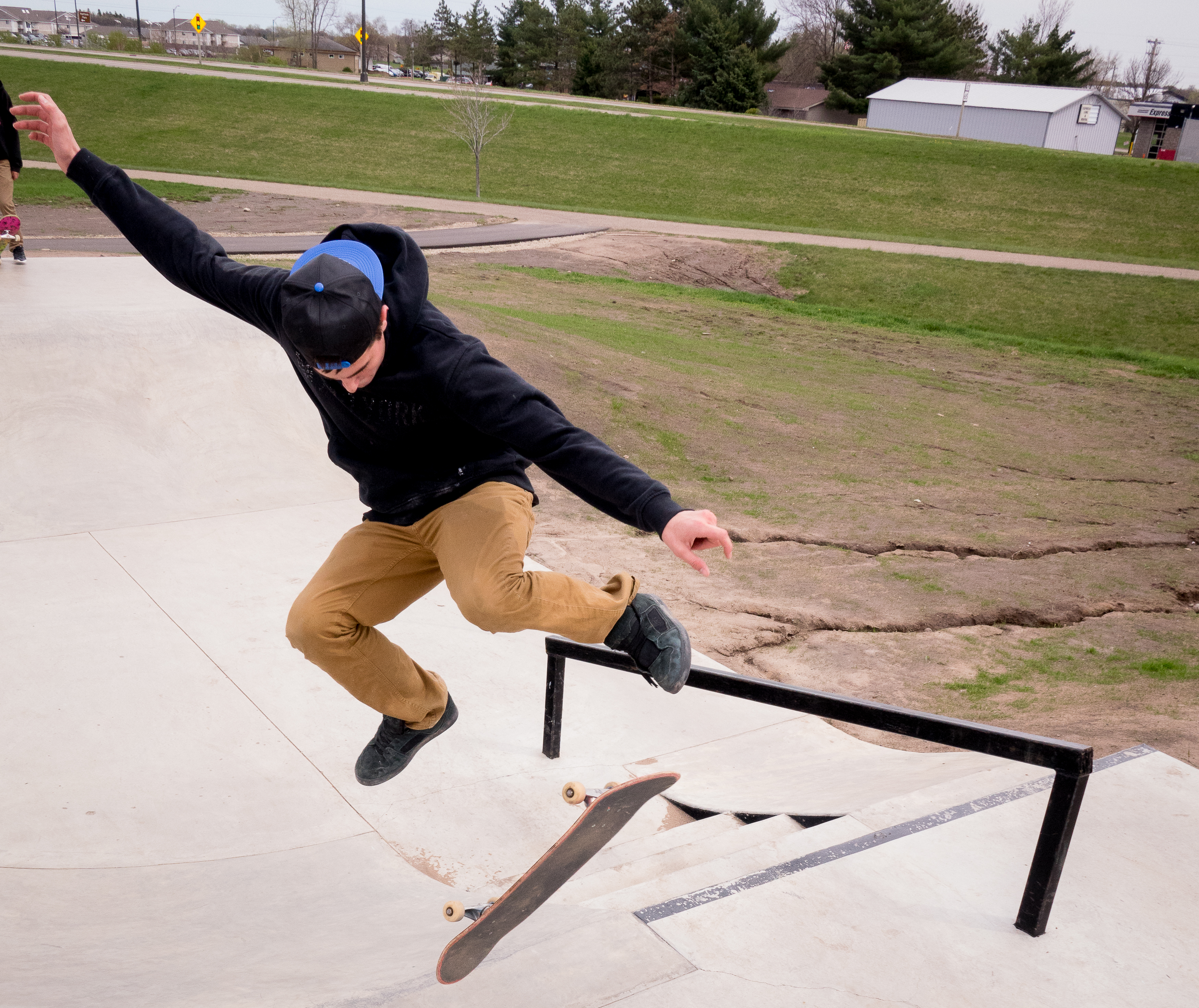 Skateboarder Doing Tricks at New Richmond Skate Park