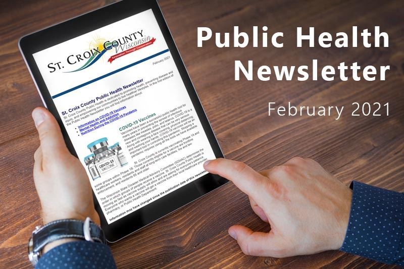 A person reading the St. Croix County Public Health Newsletter on a digital tablet.