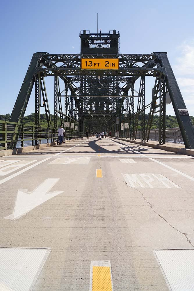 People walking on the Lift Bridge path in Stillwater connecting Minnesota and Wisconsin.